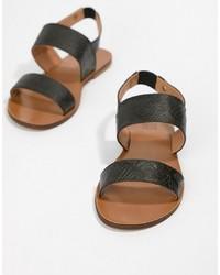 schwarze flache Sandalen aus Leder von Love Moschino