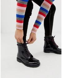 schwarze flache Stiefel mit einer Schnürung aus Leder von ASOS DESIGN