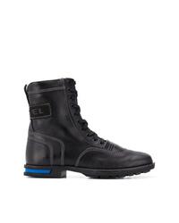 schwarze flache Stiefel mit einer Schnürung aus Leder von Diesel
