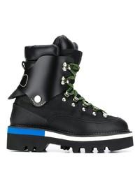 schwarze flache Stiefel mit einer Schnürung aus Leder von Dsquared2