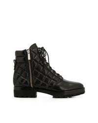 schwarze flache Stiefel mit einer Schnürung aus Leder von MICHAEL Michael Kors