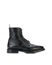 schwarze flache Stiefel mit einer Schnürung aus Leder von Thom Browne