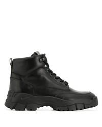 schwarze flache Stiefel mit einer Schnürung aus Leder von Tod's