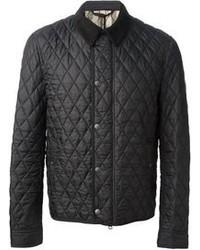 schwarze gesteppte Jacke mit einer Kentkragen und Knöpfen von Burberry