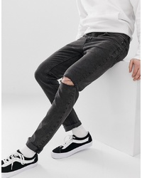 schwarze Jeans mit Destroyed-Effekten von Cheap Monday