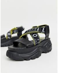 schwarze klobige flache Sandalen aus Leder von Buffalo