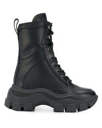 schwarze klobige flache Stiefel mit einer Schnürung aus Leder von Prada
