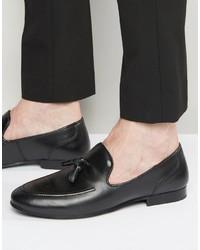 Schwarze Leder Slipper mit Quasten
