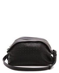 schwarze Lederhandtasche mit Ausschnitten von See by Chloe