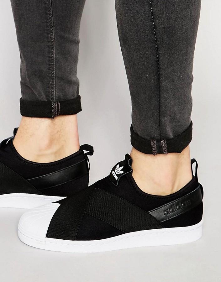 schwarze Slip On Sneakers aus Leder von adidas