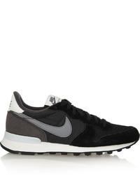 Schwarze Sportschuhe von Nike