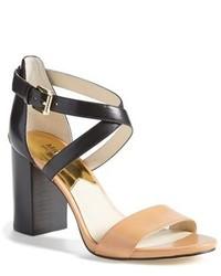 schwarze und gelbbraune Leder Sandaletten