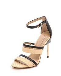 schwarze und gelbbraune Leder Sandaletten von BCBGMAXAZRIA