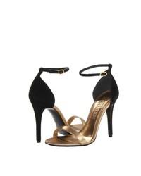 schwarze und goldene Leder Sandaletten