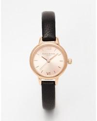 schwarze und goldene Leder Uhr von Burton