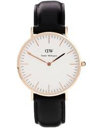schwarze und goldene Leder Uhr von Daniel Wellington