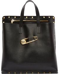 Schwarze und goldene Shopper Tasche aus Leder kombinieren