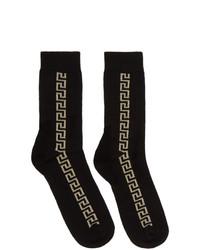 schwarze und goldene Socken von Versace