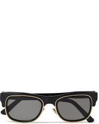 schwarze und goldene Sonnenbrille