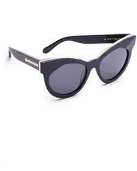 schwarze und goldene Sonnenbrille von Karen Walker