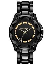schwarze und goldene Uhr
