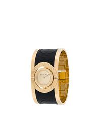 schwarze und goldene Uhr von Gucci