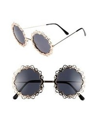 schwarze und goldene verzierte Sonnenbrille