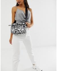 schwarze und weiße bedruckte Leder Umhängetasche von DKNY