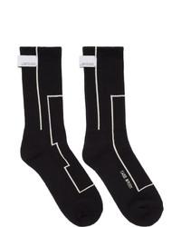 schwarze und weiße bedruckte Socken von C2h4