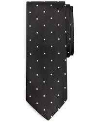 schwarze und weiße gepunktete Krawatte