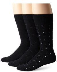 schwarze und weiße gepunktete Socken