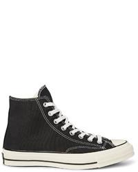 schwarze und weiße hohe Sneakers aus Segeltuch von Converse