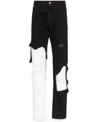 schwarze und weiße Jeans mit Destroyed-Effekten