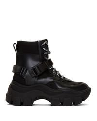 schwarze und weiße klobige flache Stiefel mit einer Schnürung aus Leder von Prada
