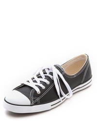 schwarze und weiße Leder niedrige Sneakers