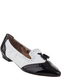 schwarze und weiße Leder Slipper mit Quasten
