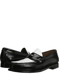 schwarze und weiße Leder Slipper