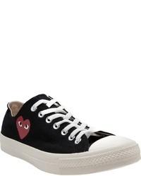 schwarze und weiße niedrige Sneakers
