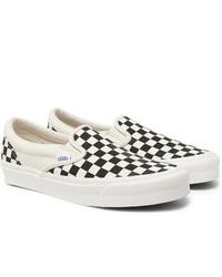 schwarze und weiße Slip-On Sneakers aus Segeltuch mit Karomuster von Vans