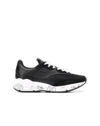 schwarze und weiße Sportschuhe von Premiata