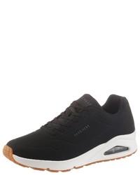 schwarze und weiße Sportschuhe von Skechers