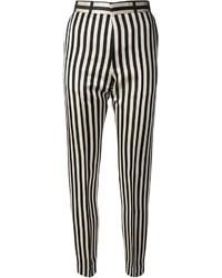 schwarze und weiße vertikal gestreifte enge Hose