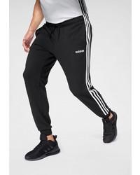 schwarze und weiße vertikal gestreifte Jogginghose von adidas