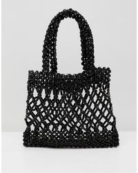 schwarze Perlen Clutch von ASOS DESIGN