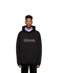 schwarzer bedruckter Pullover mit einem Kapuze von Vetements