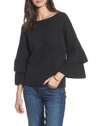 schwarzer Pullover mit einem Rundhalsausschnitt mit Rüschen