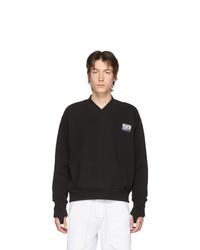 schwarzer Pullover mit einem V-Ausschnitt von Boramy Viguier
