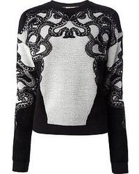 schwarzer und weißer bestickter Pullover mit einem Rundhalsausschnitt