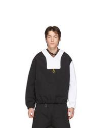 schwarzer und weißer Pullover mit einem V-Ausschnitt von Boramy Viguier