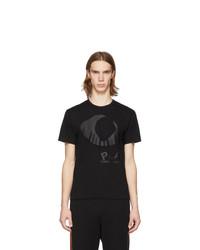 schwarzes bedrucktes T-Shirt mit einem Rundhalsausschnitt von Comme Des Garcons Play